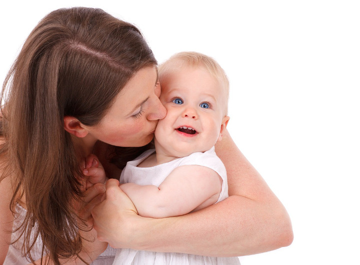 Mother kissing smiling baby - 360 have become social media consultants to Grobrain baby bonding specialists