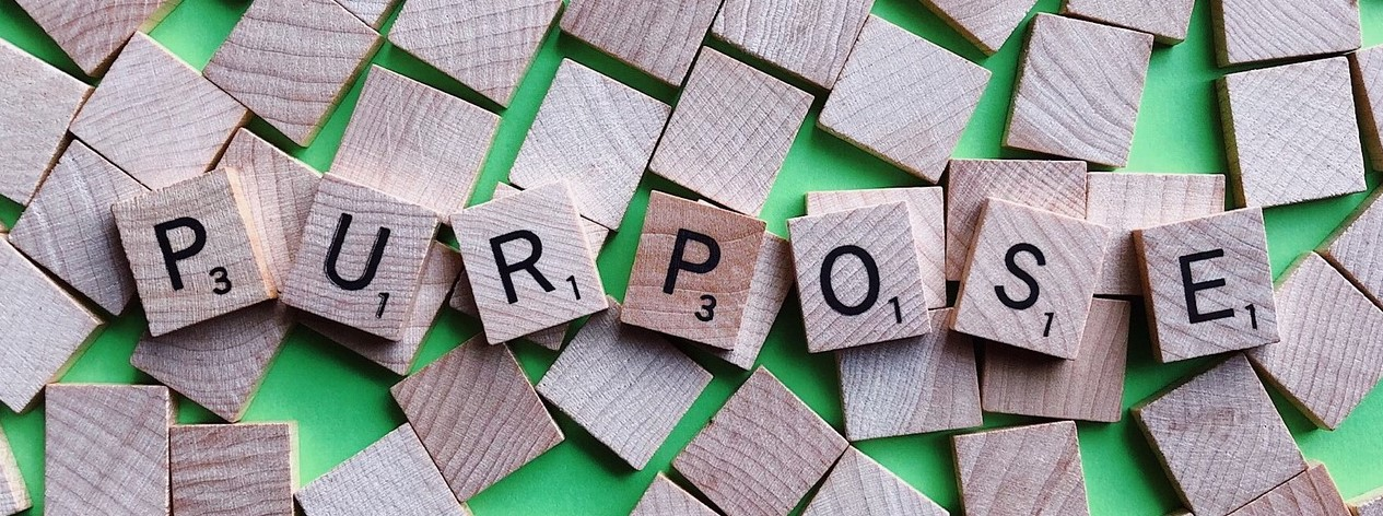 Scrabble tiles spelling the word purpose