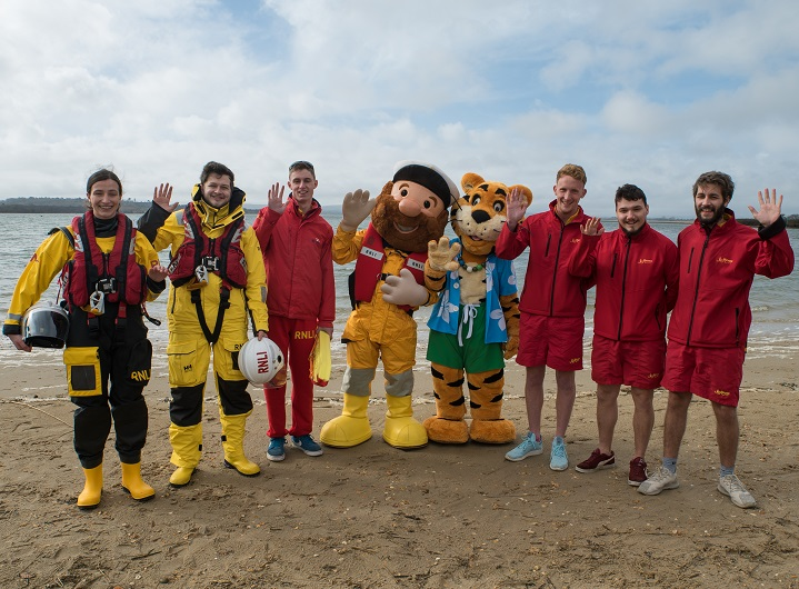 line of people and charity partnership mascots